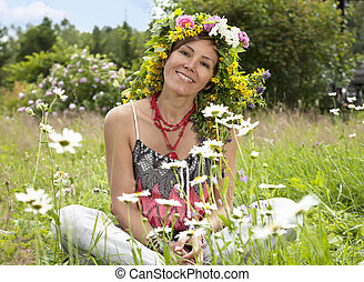 Portrait of hippie girl in a wreath