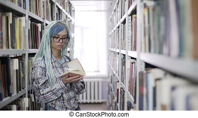 Portrait of hipster woman reading book in library - Portrait...