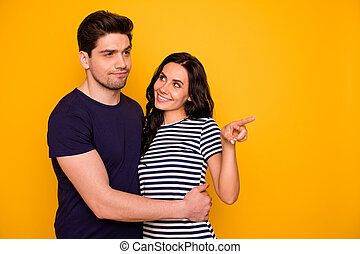 Portrait of his he her she nice-looking attractive lovely charming cheerful cheery people married spouses doubtful guy looking expecting far future isolated over bright vivid shine yellow background