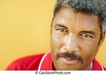 portrait of hispanic mature man staring at camera - 50 years...