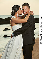 Portrait of hispanic wedding couple