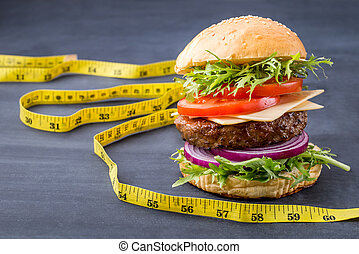 homemade hamburger with measuring tape