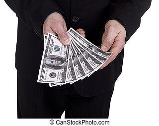 human hand holding dollars