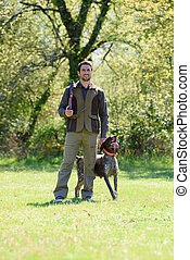 portrait of hunter and dog