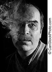 Portrait of in cigarette smoke