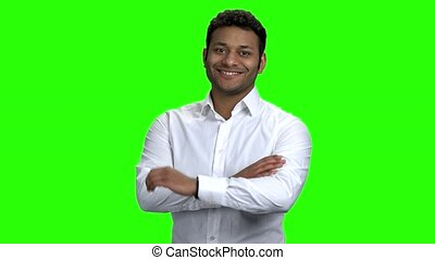 Portrait of Indian businessman on green screen.