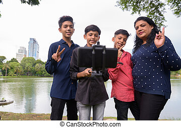 Portrait of Indian family relaxing together at the park