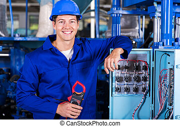 industrial electrician with insulation tester - portrait of...