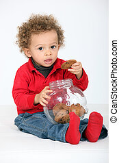 portrait of infant eating cookies