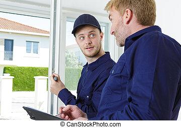 portrait of insulated door installer talking
