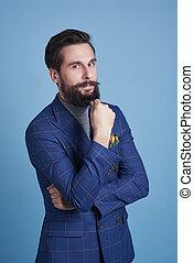 Portrait of intelligent businessman st studio shot