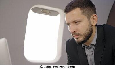 Portrait of investor expert analyst man working on laptop in...