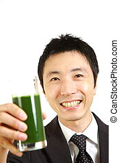 green vegetable juice - portrait of Japanese businessman...
