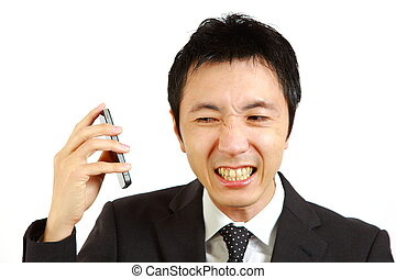 complaint call - portrait of Japanese businessman receives...