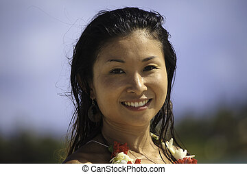 portrait of japanese woman at the beach