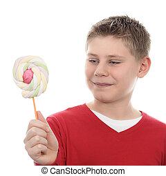boy looking at lollipop