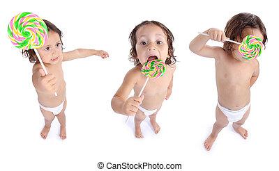 joyful little boy with candy
