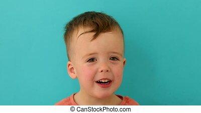 Portrait of kid who talks with pleasure and joy - Portrait...