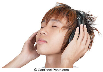 Portrait of Korean teenager enjoying music