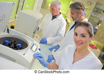 Portrait of lab worker next to equipment