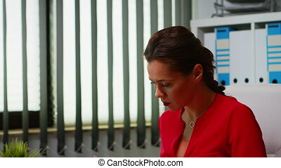 Portrait of hispanic lady using computer in modern office. Entrepreneur working in professional workspace, workplace in personal corporate company typing on pc keyboard looking at desktop