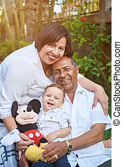 Portrait of latino grandparents