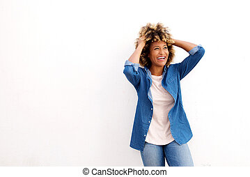 laughing african american woman standing against white background