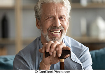 Portrait of laughing positive middle aged retired disabled ...