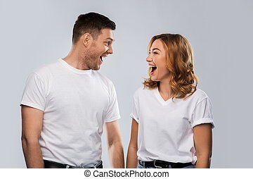 portrait of laughinh couple in white t-shirts