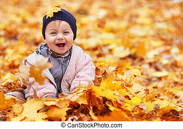 portrait of little baby girl in the autumn park