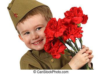 Portrait of little boy dressed in Soviet military uniform
