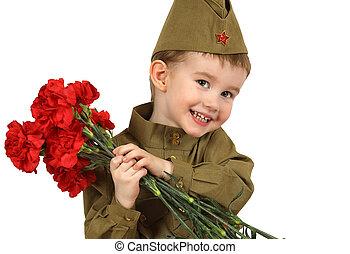 Portrait of little boy in Soviet military uniform