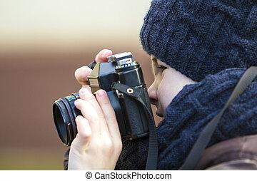 Portrait of little boy with vintage photo camera