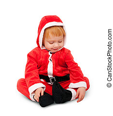 Portrait of little cute baby in red suite of Santa isolated...