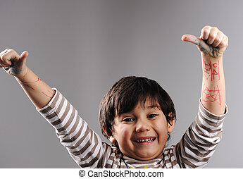 Portrait of little cute boy giving the thumbs-up sign