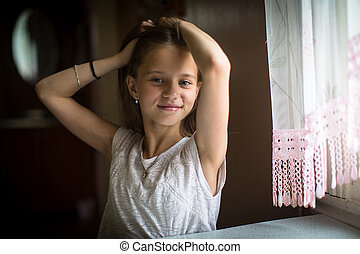Portrait of little cute girl posing for the camera.