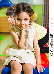 Portrait of little cute latin girl in daycare