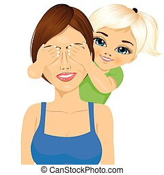 little daughter covering her happy mother eyes with her hands smiling