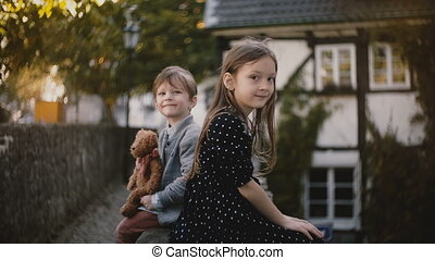 Portrait of little European boy and girl. Brother and sister...