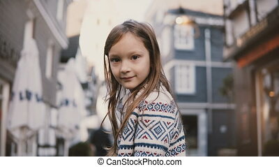 Portrait of little European girl 5-7 years old. Posing at...