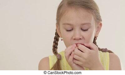 Portrait of little girl biting apple