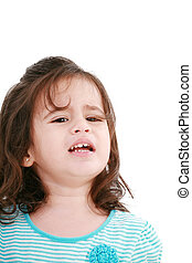 Portrait of little girl crying. Isolated on white background.