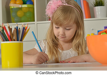 Little girl drawing at home