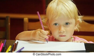 portrait of little girl drawing pencils on white paper