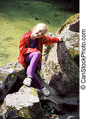 Portrait of Little Girl in Autumn Park