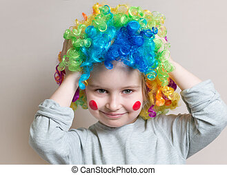 Portrait of little girl in colourful wig