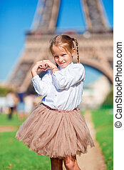 Portrait of little girl in Paris background the Eiffel tower