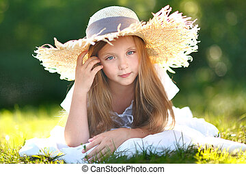 portrait of little girl in straw hat