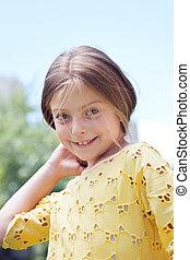 portrait of little girl in summer e