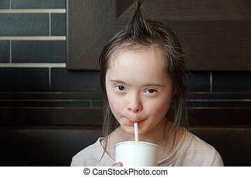 Portrait of little girl in the cafeteria